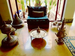 A traditional Moroccan tea set up in the lobby serving.....